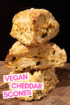 """stack of 3 cheddar jalapeño scones with a text overlay that reads """"vegan cheddar scones"""""""