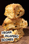 """stack of 3 cheddar jalapeño scones with a text overlay that reads """"vegan jalapeño scones"""""""