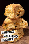 """stack of 3 cheddar jalapeño scones with a text overlay that reads """"cheddar jalapeño scones"""""""