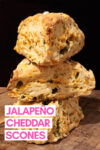 """stack of 3 cheddar jalapeño scones with a text overlay that reads """"jalapeño cheddar scones"""""""