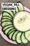 "creamy lemon dill dressing in a bowl surrounded by cucumber slices and a text overlay that reads ""vegan dill dressing"""