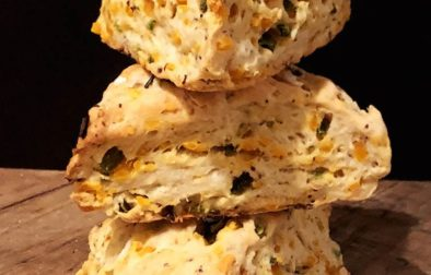 three cheddar jalapeño scones stacked on top of each other