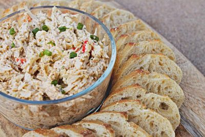 bowl of crab salad with french baguette slices
