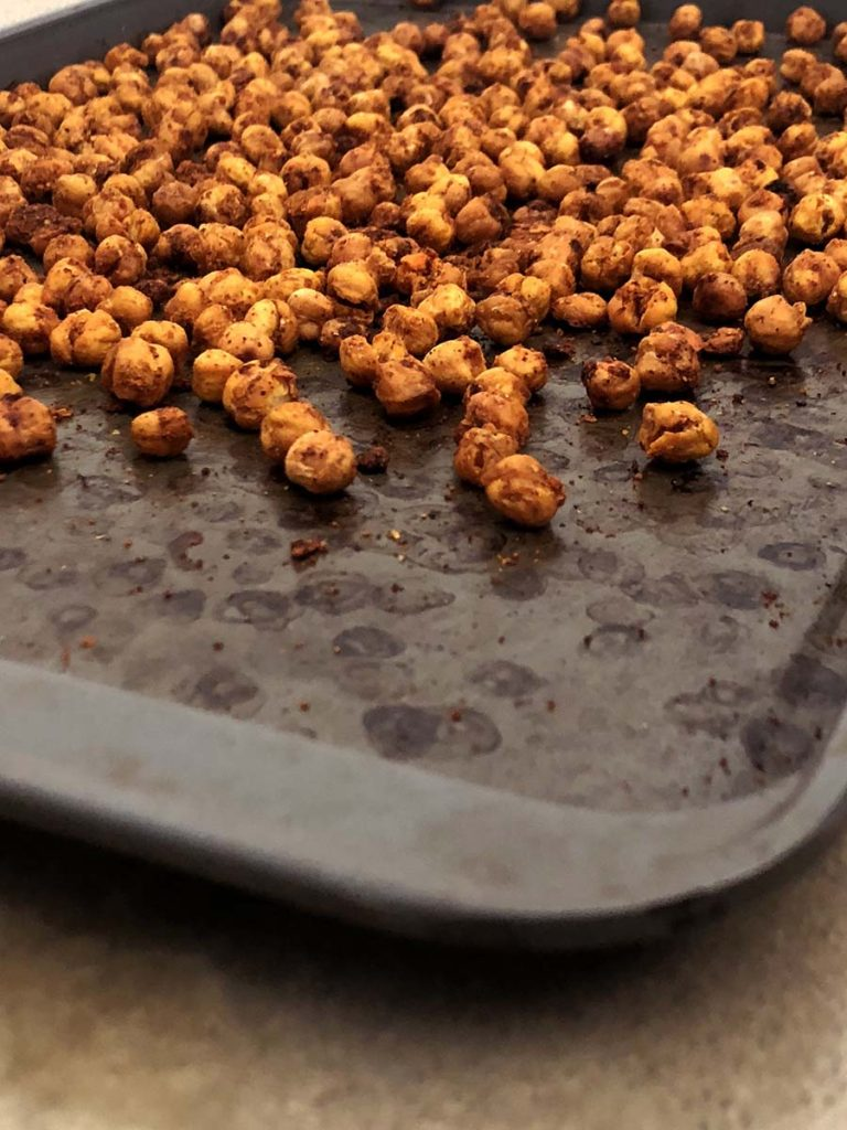 buffalo spiced crunchy chickpeas on a baking sheet