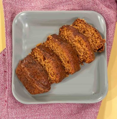 Vegan Pumpkin Bread on a plate with a red napkin