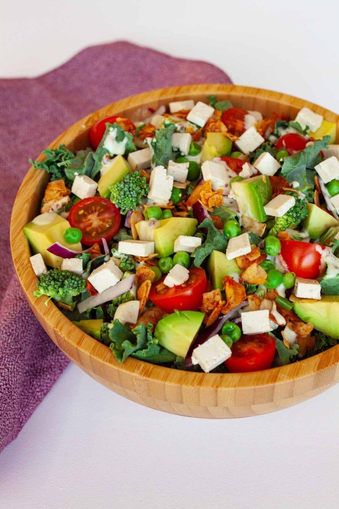 bowl of cobb salad with red napkin