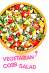 """vegan cobb salad with a text overlay that reads """"vegetarian cobb salad recipe"""" and an arrow pointing toward the bowl"""