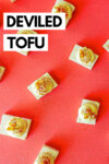 """deviled tofu eggs spread across a red background with a text overlay that reads """"deviled tofu"""""""