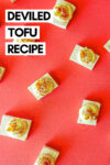 """deviled tofu eggs spread across a red background with a text overlay that reads """"deviled tofu recipe"""""""