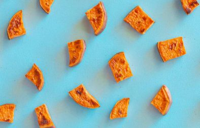 Perfect Roasted Sweet Potato Pieces on a baby blue background