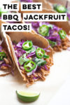 "side shot of bbq jackfruit tacos with lime wedges and a text overlay that reads ""the best bbq jackfruit tacos"""