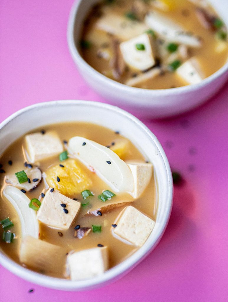 two bowls of vegan hot and sour soup