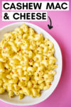 "bowl of cashew mac and cheese with a text overlay that reads ""cashew mac & cheese"" with an arrow pointing toward the bowl"