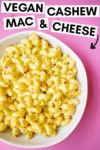 """bowl of cashew mac and cheese with a text overlay that reads """"vegan cashew mac & cheese"""" with an arrow pointing toward the bowl"""
