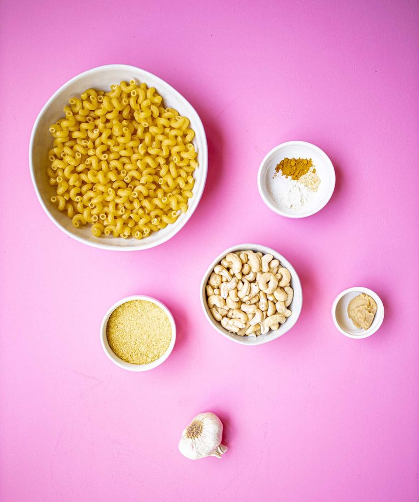 cashew mac and cheese ingredients: noodles, nutritional yeast, cashews, miso, spices, and garlic