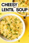 "two bowls of cheesy red lentil soup and a text overlay that reads ""cheesy lentil soup"" with an arrow pointing toward one of the bowls"
