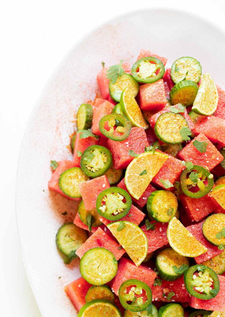 large plate filled with chili lime watermelon cucumber salad