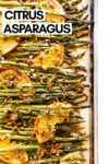 "oven roasted asparagus with citrus and pistachio on a baking sheet with a text overlay that reads ""citrus asparagus"""