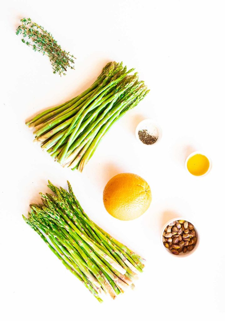ingredient spread of asparagus, thyme, orange, extra virgin olive oil, pistachios, and salt and pepper