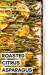 "oven roasted asparagus displayed horizontally with citrus, thyme, and pistachio on a baking sheet with parchment paper on a white background with text overlay that reads ""roasted citrus asparagus"""