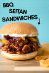"""bbq chicken sandwich with chips on the side and a text overlay that reads """"bbq seitan sandwiches"""" and an arrow pointing toward to the sandwich"""