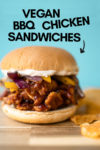"""bbq chicken sandwich with chips on the side and a text overlay that reads """"vegan bbq chicken sandwiches"""" and an arrow pointing toward to the sandwich"""