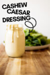 "vegan caesar dressing with a plate of greens and a text overlay that reads ""cashew caesar dressing"""