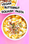 """two bowls of butternut squash pasta with almond oregano topping and a text overlay that reads """"vegan butternut squash pasta"""""""