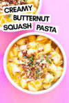 """two bowls of butternut squash pasta with almond oregano topping and a text overlay that reads """"creamy butternut squash pasta"""""""