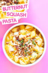 """two bowls of butternut squash pasta with almond oregano topping and a text overlay that reads """"butternut squash pasta"""""""