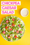 """vegan caesar salad with crunchy chickpeas and a side of caesar dressing with a text overlay that reads """"chickpea caesar salad"""""""