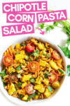"a bowl of chipotle corn past salad surrounded by cilantro leaves with a text overlay that reads ""chipotle corn pasta salad"" with an arrow pointing toward the bowl"