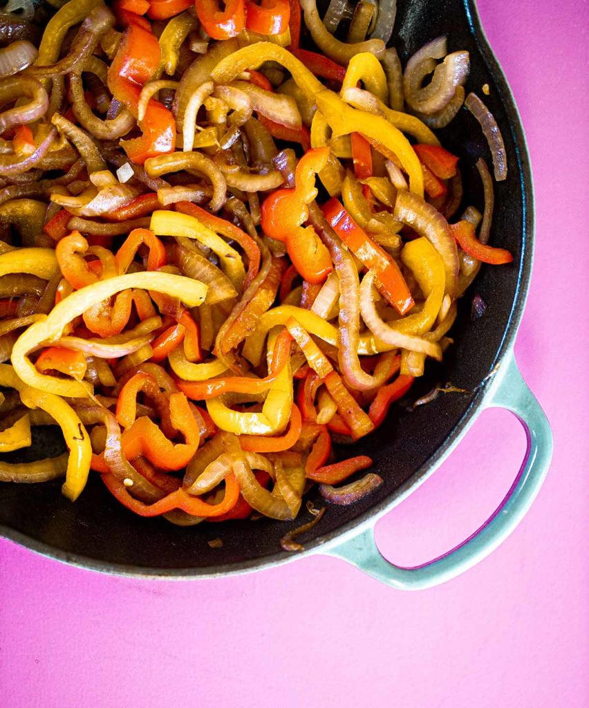 sautéed peppers and onions in a skillet