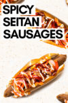 """array of spicy seitan sausages in buns with sautéed peppers and onions, BBQ sauce and vegan mayo and a text overlay that reads """"spicy seitan sausages"""""""