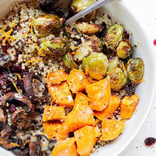 a sweet potato quinoa bowl with a fork