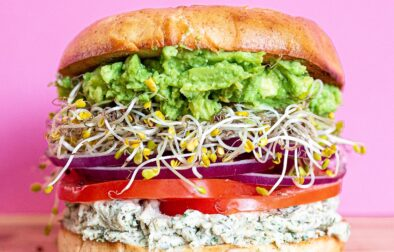 giant bagel sandwich with herb cream cheese, tomato, red onion, sprouts and avocado