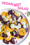 "plate with roasted beet salad with green goddess dressing and a text overlay that reads ""vegan beet salad"" and an arrow pointing toward the salad"