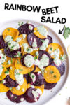 "plate with roasted beet salad with green goddess dressing and a text overlay that reads ""rainbow beet salad"" and an arrow pointing toward the salad"