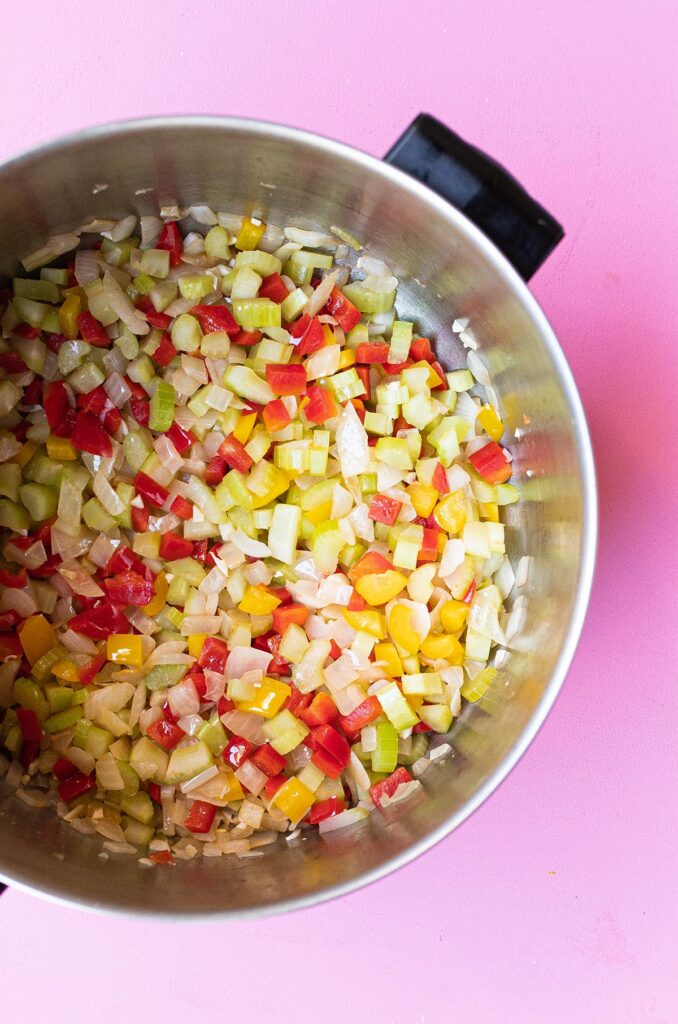 sautéed onions, bell peppers, celery and garlic in a large pot