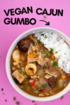 "bowl of vegan cajun gumbo with a text overlay that reads ""vegan cajun gumbo"" with an arrow pointing toward the bowl"