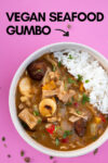 "bowl of vegan cajun gumbo with a text overlay that reads ""vegan seafood gumbo"" with an arrow pointing toward the bowl"