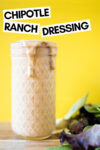 """small mason jar filled with chipotle ranch dressing and some greens off to the side with a text overlay that reads """"chipotle ranch dressing"""""""