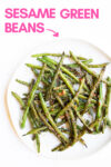 "plate of sesame miso green beans with a text overlay that reads ""sesame green beans"" with an arrow pointing toward the plate"