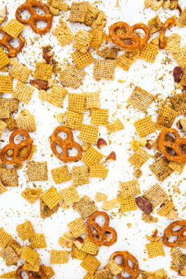 sour cream and onion snack mix spread across a white background