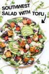 "southwest salad with tofu and chipotle ranch dressing surrounded by cilantro leaves and a text overlay that reads ""southwest salad with tofu"""