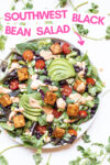 "southwest salad with tofu and chipotle ranch dressing surrounded by cilantro leaves and a text overlay that reads ""southwest black bean salad"""