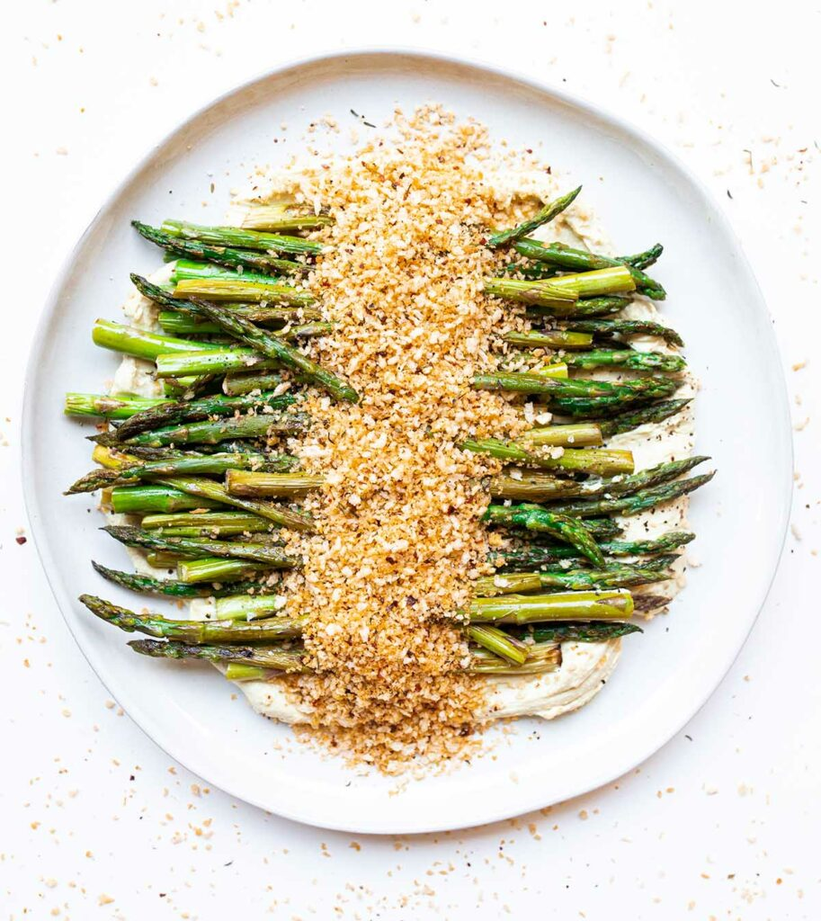plate of stovetop asparagus with tofu ricotta and spicy bread crumbs
