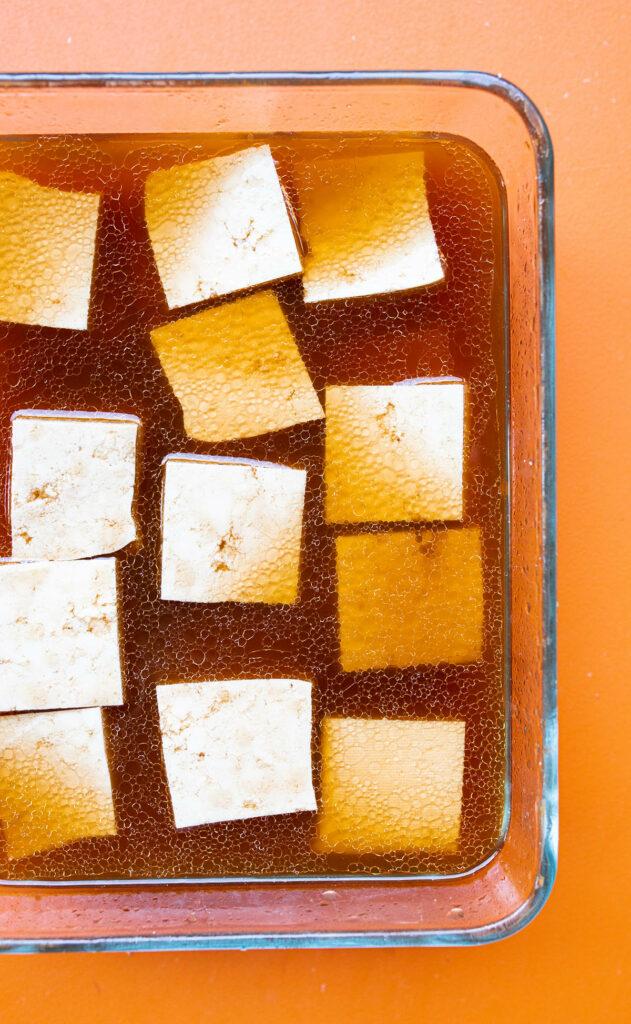 tofu pieces marinating in sesame oil, rice vinegar, tamari, and water
