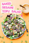"a plate of sesame crusted tofu salad with peanut dressing off to the side with a text overlay that reads ""baked sesame tofu salad"""