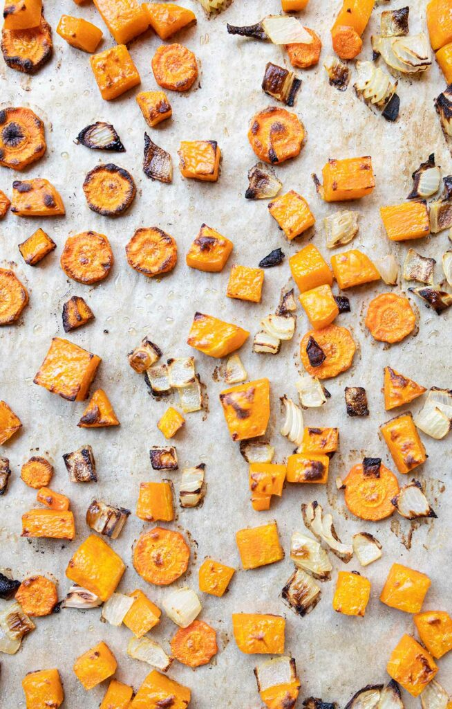 roasted carrots, butternut squash, and carrots on a baking sheet